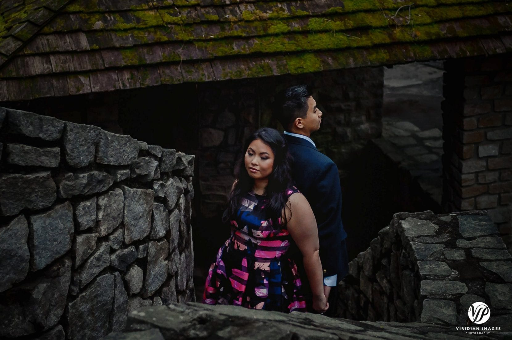 couple back to back on stone stairs in stone mountain park atlanta engagement photo