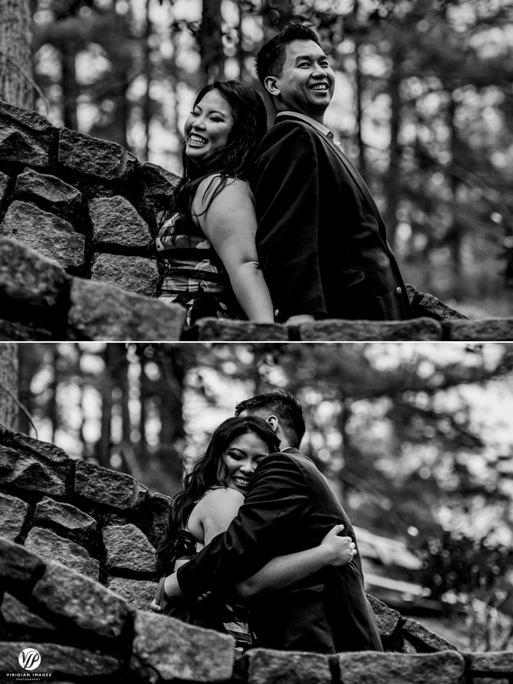 couple laughing back to back on stone stairs engagement photo session stone mountain park atlanta