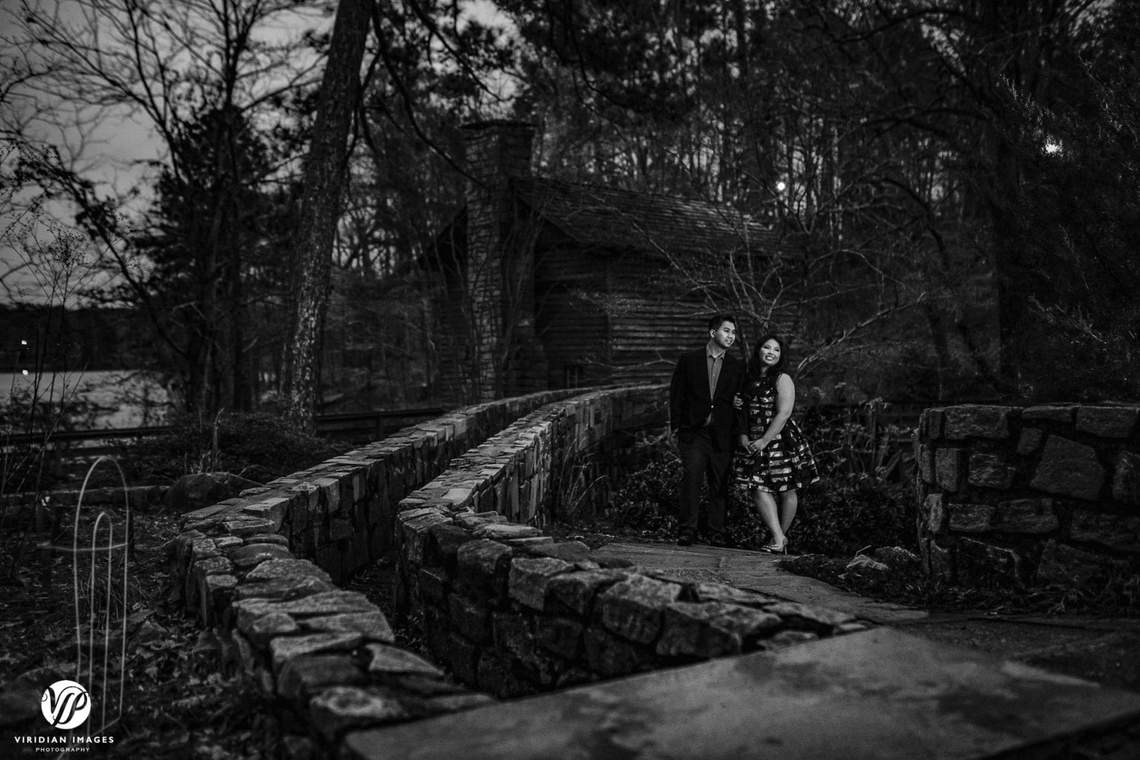 couple walking along stone path atlanta stone mountain park engagement photo