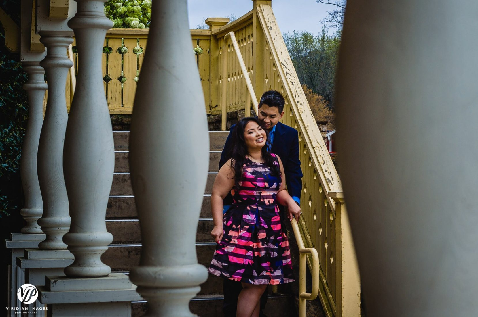 couple laughing down stairs in stone mountain park atlanta engagement photo