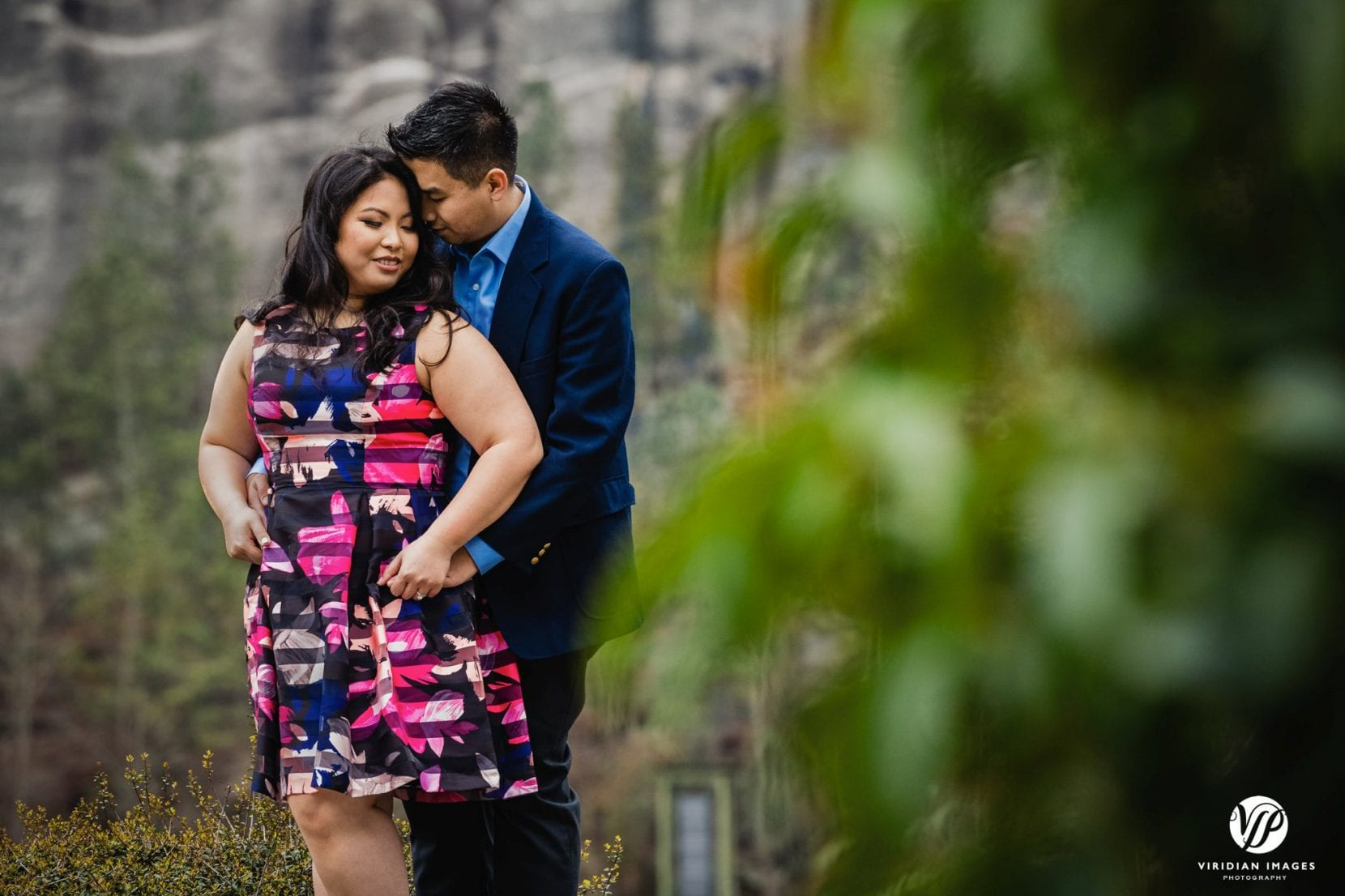 romantic engagement portrait on ledge stone mountain park