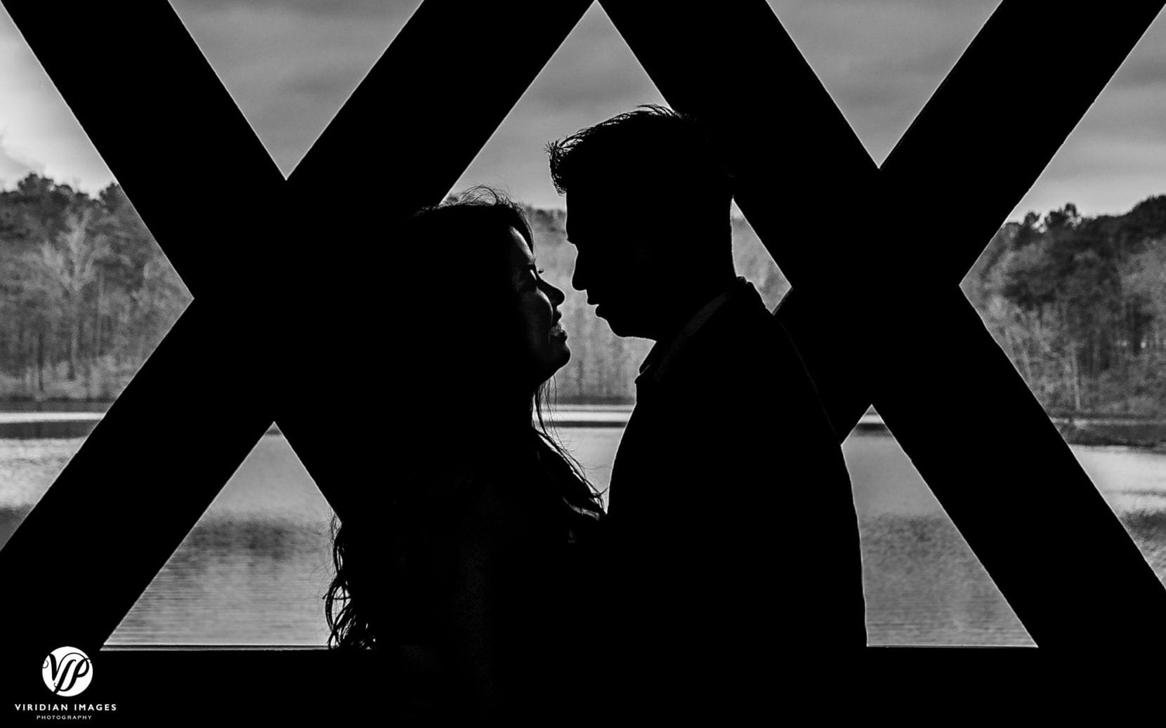silhouette black and white couple looking at each other covered bridge in atlanta stone mountain park engagement photo
